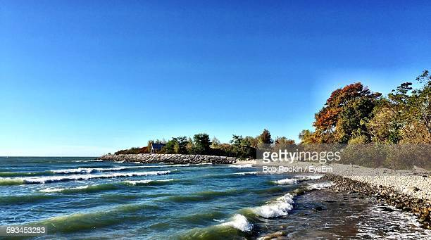scenic view of beach against clear sky - マーカム ストックフォトと画像