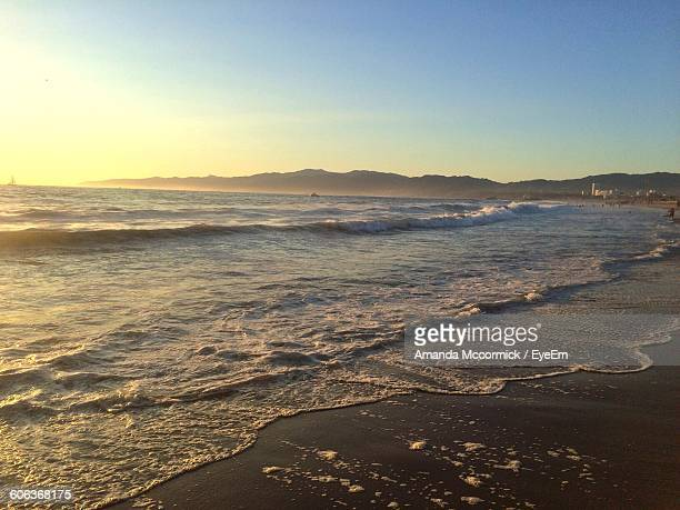 scenic view of beach against clear sky - カリフォルニア州 ベニス ストックフォトと画像
