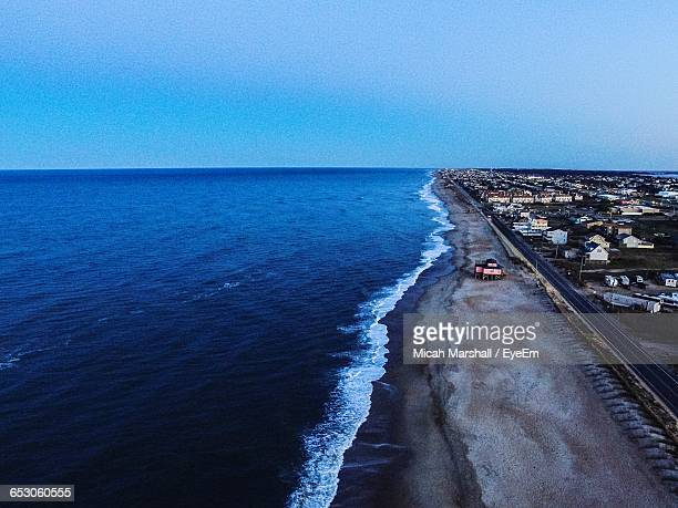 scenic view of beach against clear sky - kitty hawk beach stock pictures, royalty-free photos & images