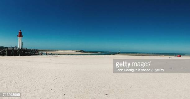 scenic view of beach against clear sky - trouville sur mer stock pictures, royalty-free photos & images