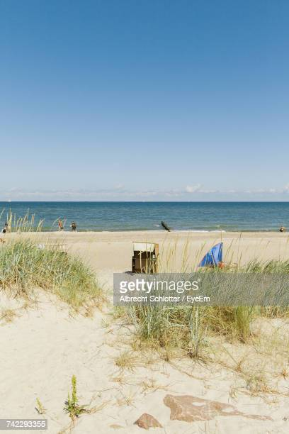 scenic view of beach against clear sky - albrecht schlotter foto e immagini stock