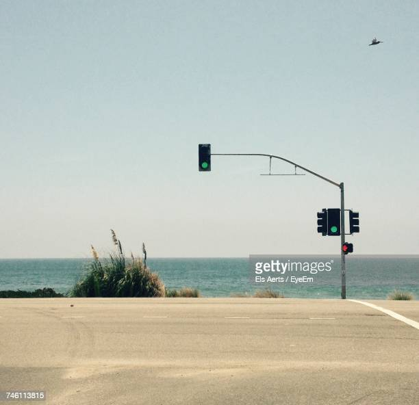 scenic view of beach against clear sky - 交通信号機 ストックフォトと画像