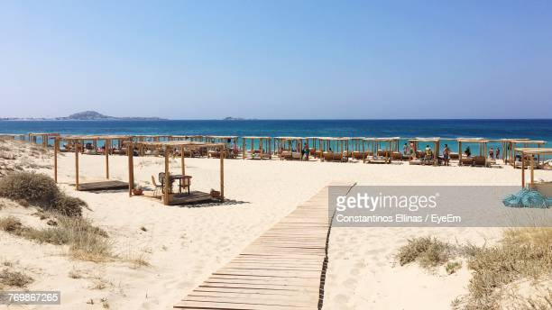 scenic view of beach against clear sky - naxos stockfoto's en -beelden