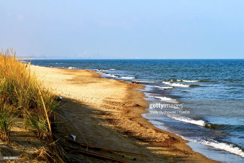 Scenic View Of Beach Against Clear Sky : Stock Photo