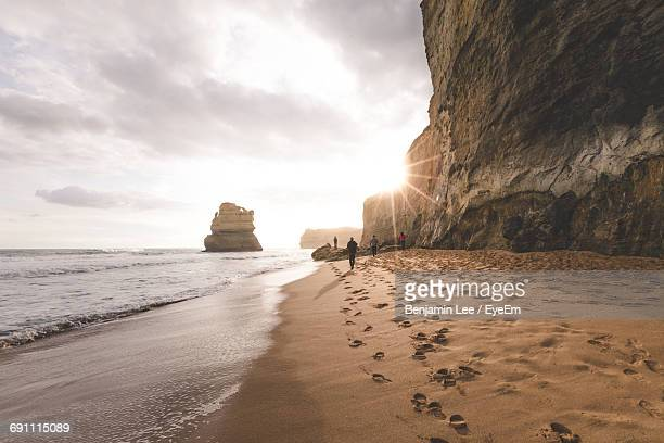 Scenic View Of Beach Against Cloudy Sky During Sunny Day