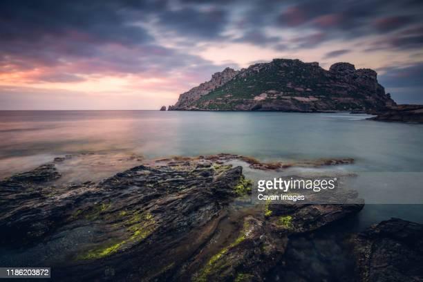 scenic view of beach against cloudy sky during sunset at murcia - murcia - fotografias e filmes do acervo