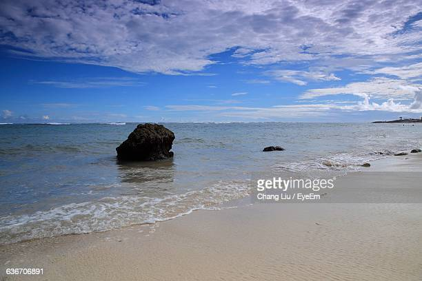 scenic view of beach against cloudy sky - liu he stock pictures, royalty-free photos & images