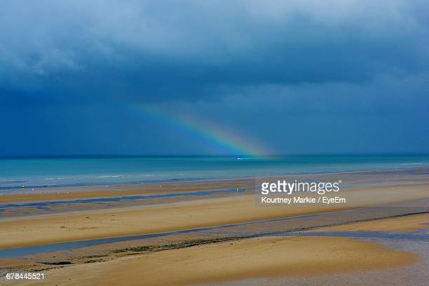 scenic view of beach against cloudy sky - omaha beach stock pictures, royalty-free photos & images