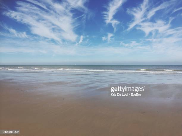 scenic view of beach against cloudy sky - west flanders stock pictures, royalty-free photos & images