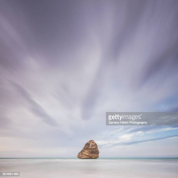scenic view of beach against cloudy sky - samere fahim stock photos and pictures