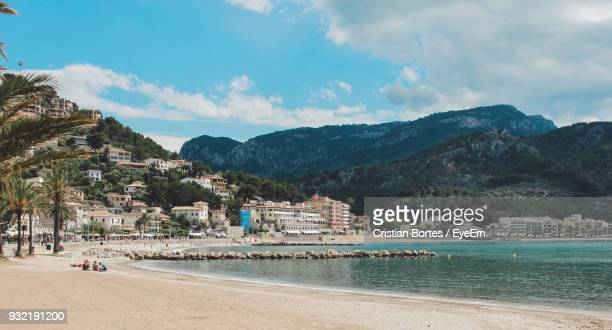 scenic view of beach against cloudy sky - palma majorca stock photos and pictures