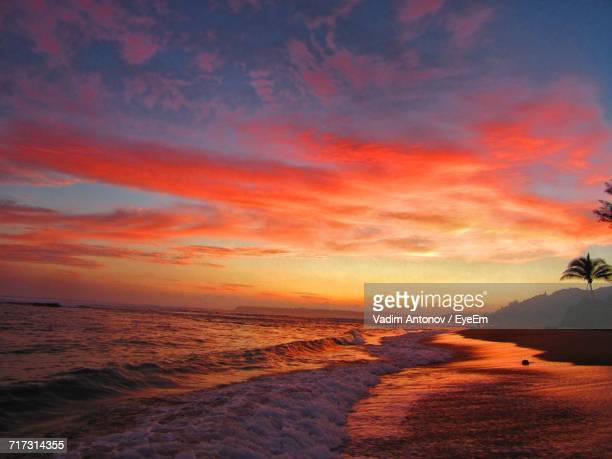 scenic view of beach against dramatic sky - antonov stock pictures, royalty-free photos & images