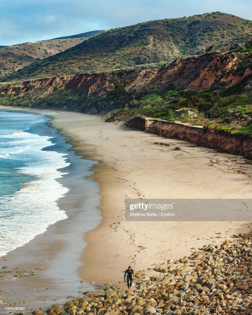 Scenic View Of Beach Against Mountains : Stock Photo