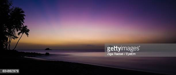 Scenic View Of Beach Against Sky At Dusk