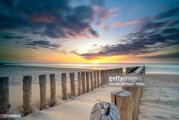 scenic view of beach against sky during sunset, middelburg, netherlands - middelburg netherlands stock pictures, royalty-free photos & images