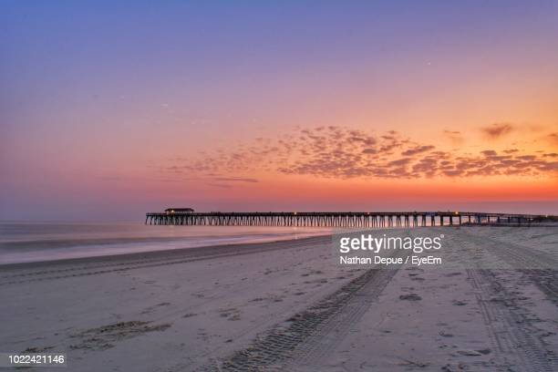 scenic view of beach against sky during sunset - file:myrtle_beach,_south_carolina.jpg stock pictures, royalty-free photos & images