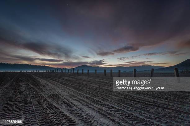 scenic view of beach against sky during sunset - east java province stock pictures, royalty-free photos & images