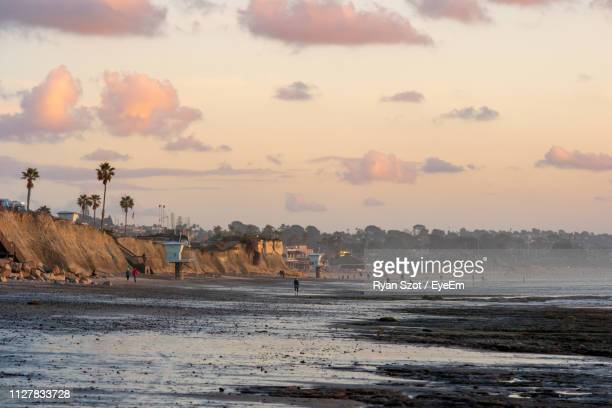 scenic view of beach against sky during sunset - carlsbad california stock pictures, royalty-free photos & images