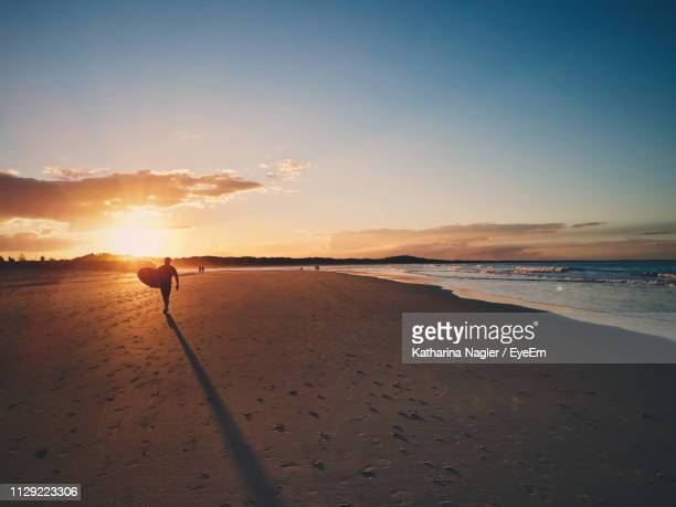 scenic view of beach against sky during sunset - sunshine coast australia stock pictures, royalty-free photos & images