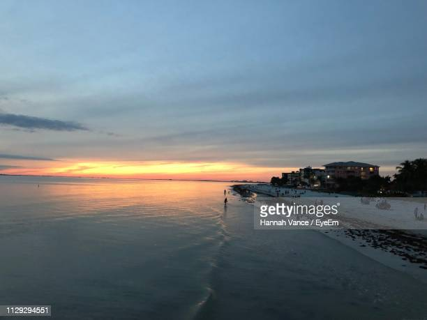scenic view of beach against sky during sunset - fort myers beach stock pictures, royalty-free photos & images