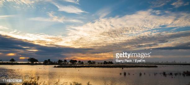 scenic view of beach against sky during sunset - tallahassee stock pictures, royalty-free photos & images