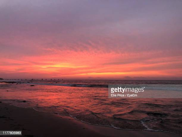 scenic view of beach against sky during sunset - ellie price stock pictures, royalty-free photos & images