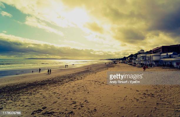 scenic view of beach against sky during sunset - andy rinkoff stock photos and pictures