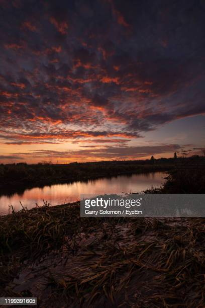 scenic view of beach against sky during sunset - northamptonshire stock pictures, royalty-free photos & images