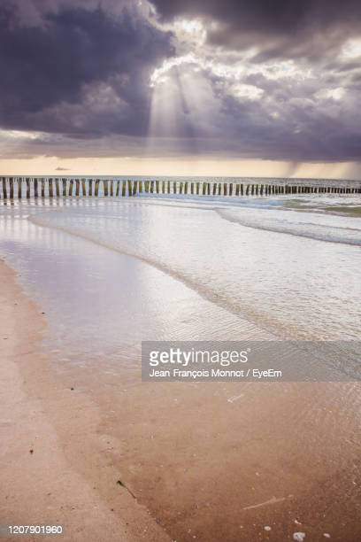 scenic view of beach against sky during sunset - calais stock pictures, royalty-free photos & images