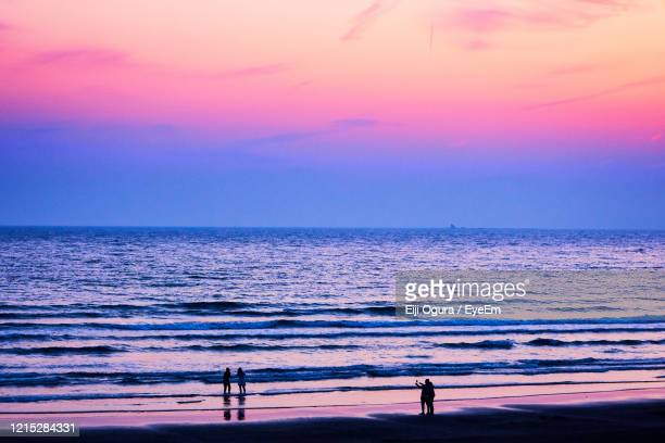 scenic view of beach against sky during sunset - golden hour stock pictures, royalty-free photos & images