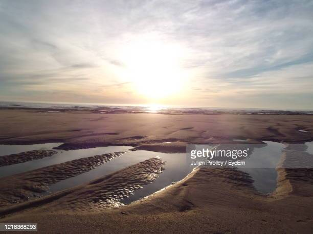 scenic view of beach against sky during sunset - loire atlantique stock pictures, royalty-free photos & images