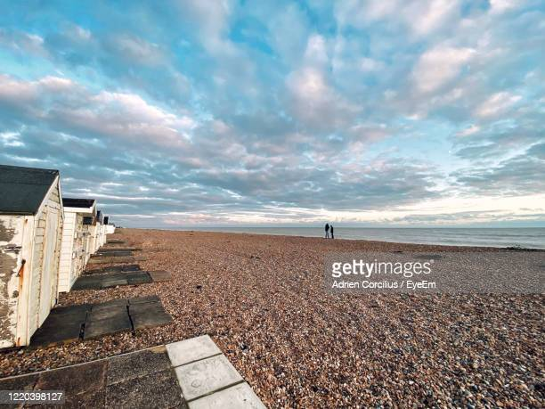 scenic view of beach against sky during sunset - west sussex stock pictures, royalty-free photos & images