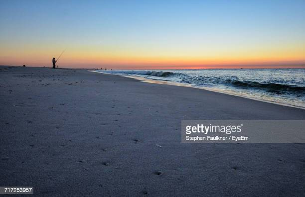 scenic view of beach against sky during sunset - wantagh stock pictures, royalty-free photos & images