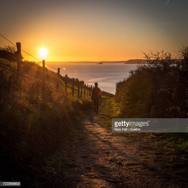 scenic view of beach against sky during sunset - mevagissey stock photos and pictures