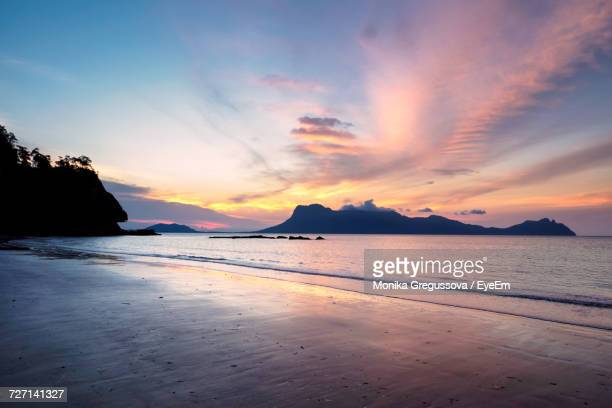 scenic view of beach against sky during sunset - monika gregussova stock pictures, royalty-free photos & images