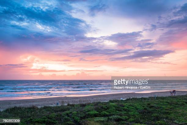 scenic view of beach against sky during sunset - south padre island stock pictures, royalty-free photos & images