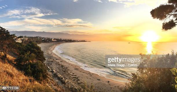 scenic view of beach against sky during sunset - santa barbara stock photos and pictures