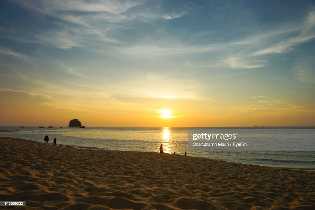 Scenic View Of Beach Against Sky During Sunset : Stock Photo