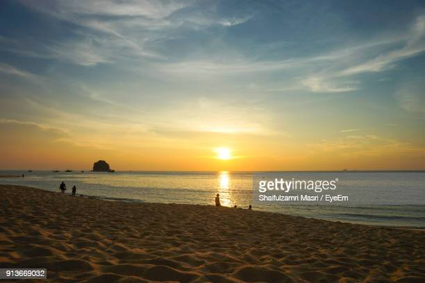scenic view of beach against sky during sunset - shaifulzamri stock pictures, royalty-free photos & images