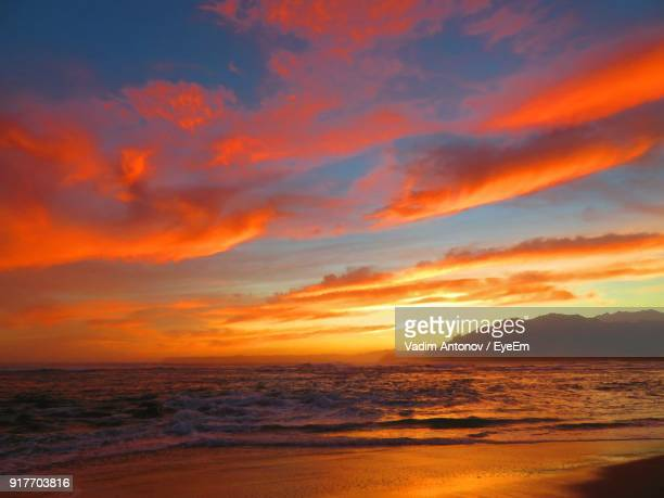 scenic view of beach against sky during sunset - antonov stock pictures, royalty-free photos & images