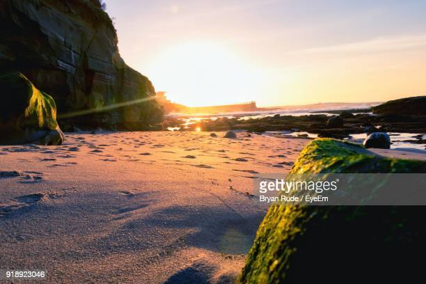 scenic view of beach against sky during sunset - la jolla stock pictures, royalty-free photos & images