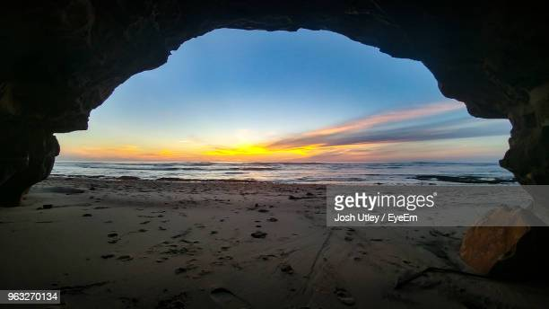 scenic view of beach against sky during sunset - josh utley stock pictures, royalty-free photos & images