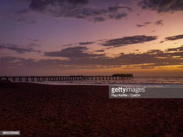 scenic view of beach against sky during sunset - keiffer stock pictures, royalty-free photos & images