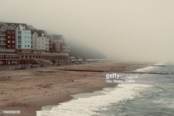 scenic view of beach against sky during winter - bournemouth stock pictures, royalty-free photos & images