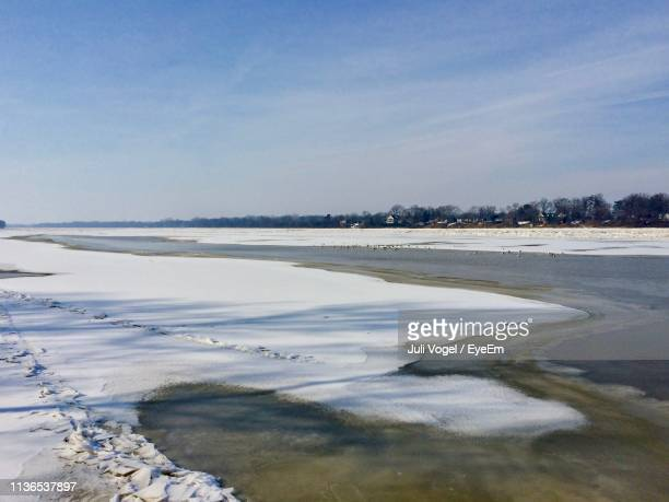 scenic view of beach against sky during winter - vogel stock pictures, royalty-free photos & images