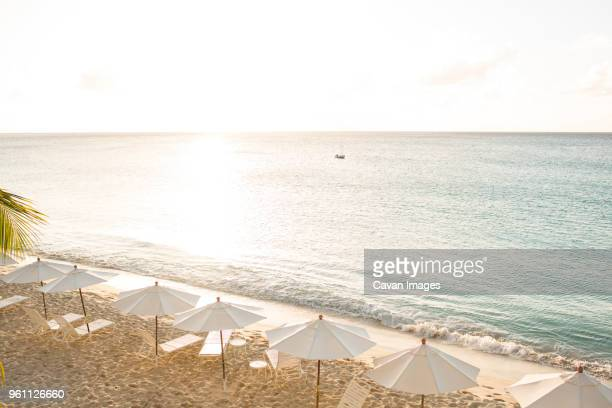 Scenic view of beach against sky on sunny day