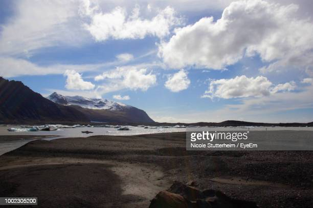 scenic view of beach against sky - stutterheim stock photos and pictures
