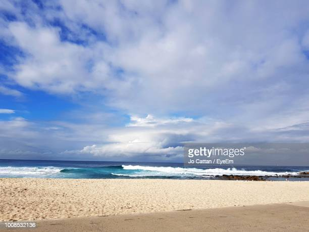scenic view of beach against sky - seascape stock pictures, royalty-free photos & images