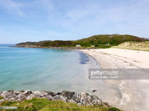 scenic view of beach against sky - mallaig stock photos and pictures
