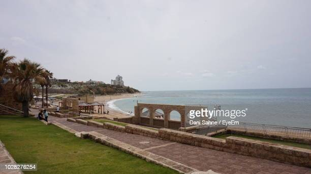 scenic view of beach against sky - sahne stock pictures, royalty-free photos & images